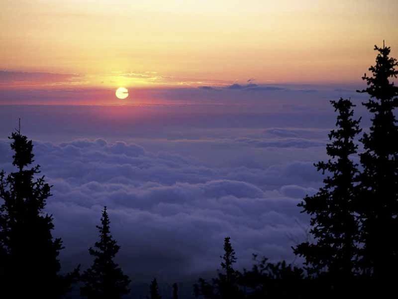Dawn sun and clouds