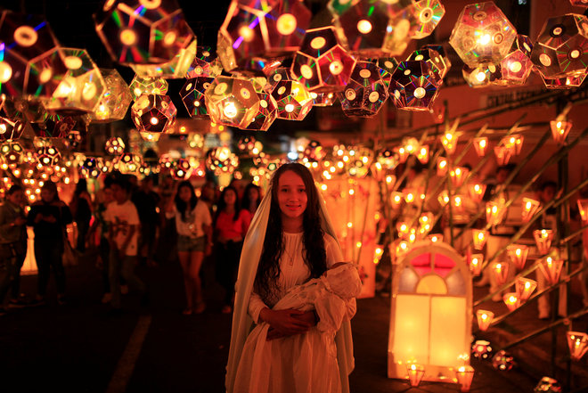 A-girl-dressed-as-the-Virgin-Mary-poses-for-a-photo-during-the-Lantern-Festival-celebrating-the-eve-of-the-nativity-of-the-Virgin-Mary